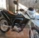 Bandidos armados rendem mãe e filho e roubam motocicleta