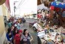 Fila desde a madrugada na Banda para troca de alimentos por chapéu comemorativo