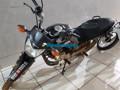 Polícia recupera moto roubada e apreende adolescente com arma de fabricação caseira